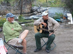 Musicians play around the fire on the shore of the Salmon River in Idaho