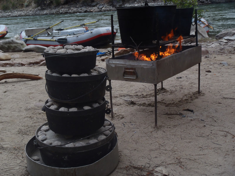 Dutch ovens stacked high for a meal on the Salmon River