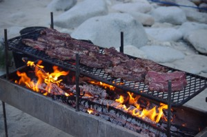 Cooking Steaks over the fire on the River of No Return